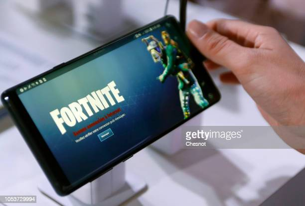 A gamer plays the video game 'Fortnite Battle Royale' developed by Epic Games on a Samsung Galaxy Note 9 smartphone during the 'Paris Games Week' on...