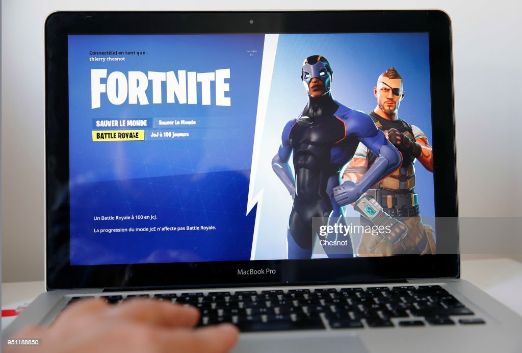 A gamer plays the video game 'Fortnite: Battle Royale' developed by People Can Fly and Epic Games on May 03, 2018 in Paris, France. Fortnite is an online video game of survival and construction available on consoles, PC and, recently, on iPhone. Released in July 2017, it has been growing in popularity in recent months. Fortnite, which brings together more than 40 million players each month around the world, brings a fortune to its creators. In March alone, revenues are estimated by the Superdata Institute at $ 220 million.