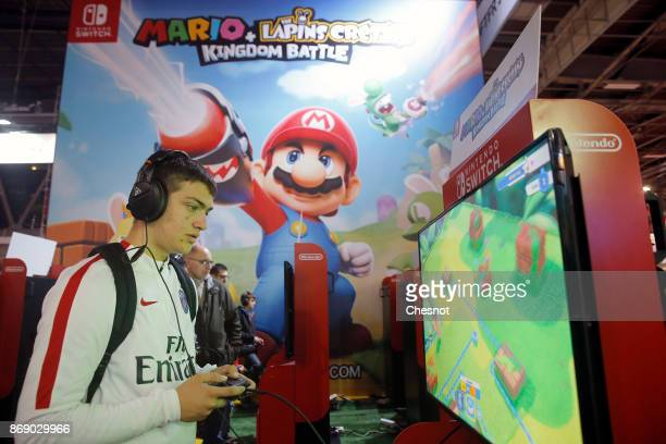 A gamer plays the video game 'Mario The lapins Cretins Kingdom Battle' developed and published by Ubisoft on a Nintendo Switch games console during...