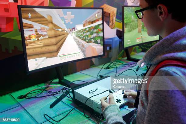 A gamer plays the video game 'Minecraft' on a Microsoft Xbox One X console during the 'Paris Games Week' on October 31 2017in Paris France 'Paris...