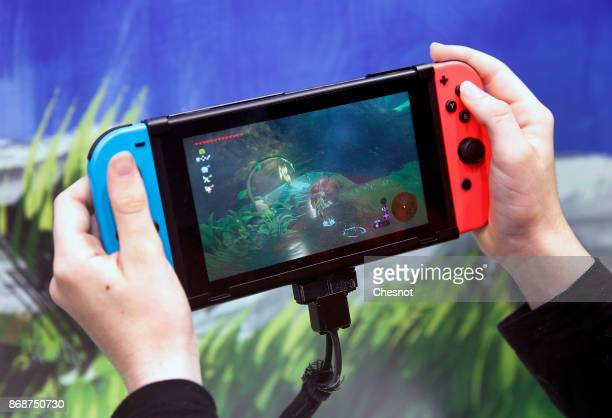 A gamer plays the video game 'The Legend of Zelda Breath of the Wild' developed and published by Nintendo on a Nintendo Switch games console during...