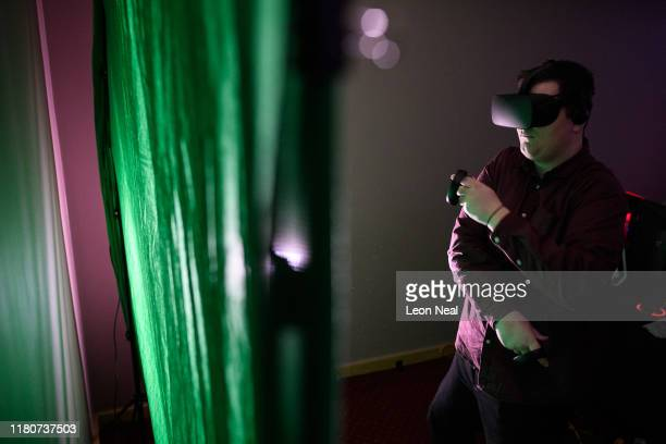 A gamer plays the VR game Beat Saber at the epicLAN esport tournament at the Kettering Conference Centre on October 12 2019 in Kettering England...