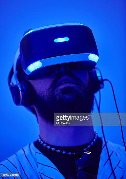 A gamer tests out Playstation VR on the Sony PS4 on September 24 2015 in Birmingham England The UK Gaming Industry contributed more than £1 billion...