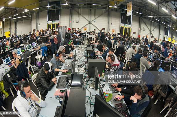 Gamers are pictured on April 4 2015 during the 16th edition of the Gamers Assembly 2015 in the 15000 square meters exhibition center of Poitiers with...