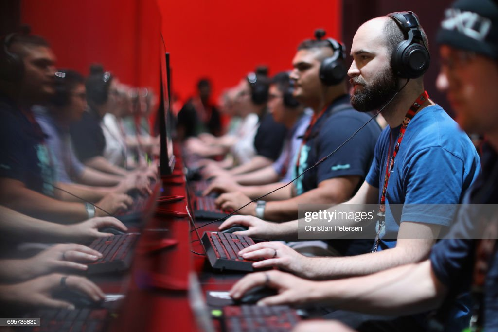 Gamers compete in PC gaming at the 'Nvidia' booth during the Electronic Entertainment Expo E3 at the Los Angeles Convention Center on June 13, 2017 in Los Angeles, California.