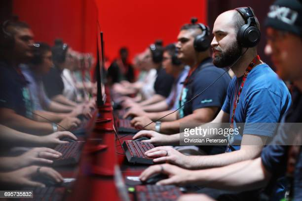 Gamers compete in PC gaming at the 'Nvidia' booth during the Electronic Entertainment Expo E3 at the Los Angeles Convention Center on June 13 2017 in...