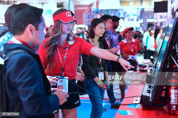 Gamers get instructions on the survival game Fortnite for Nintendo Switch at the 24th Electronic Expo or E3 2018 in Los Angeles California on June 12...