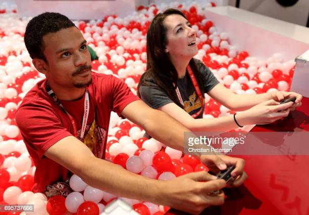 Gamers Julius Gary and EmmaLee Sherbon play the Nintendo Switch in the Nyko exhibit during the Electronic Entertainment Expo E3 at the Los Angeles...