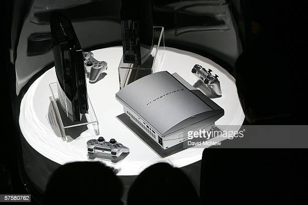 Gamers look at the newest PlayStation 3 devices on day one of the Entertainment Software Association's 2006 Electronic Entertainment Expo at the Los...