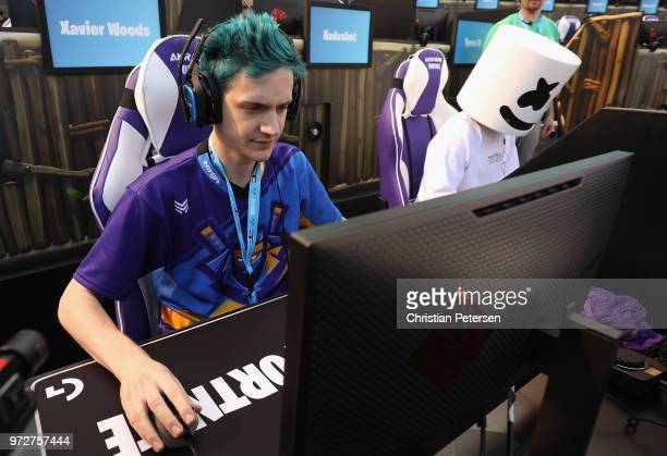 Gamers 'Ninja' and 'Marshmello' compete in the Epic Games Fortnite E3 Tournament at the Banc of California Stadium on June 12 2018 in Los Angeles...