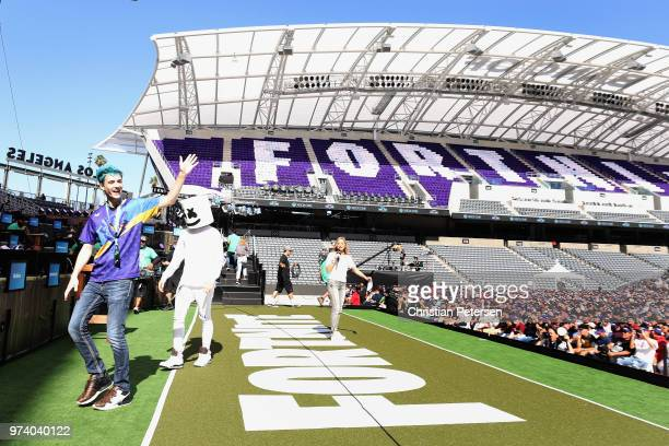Gamers 'Ninja' and 'Marshmello' walk onstage during the Epic Games Fortnite E3 Tournament at the Banc of California Stadium on June 12 2018 in Los...