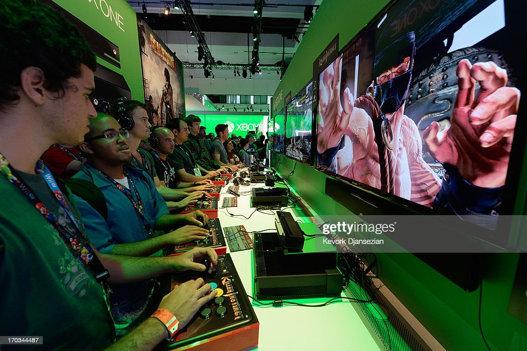 Gamers play a game on the Xbox One console in the Microsoft Exbox Xbox booth during the Electronics Expo 2013 at the Los Angeles Convention Center on June 11, 2013 in Los Angeles, California. Thousands are expected to attend the annual three-day convention to see the latest games and announcements from the gaming industry.
