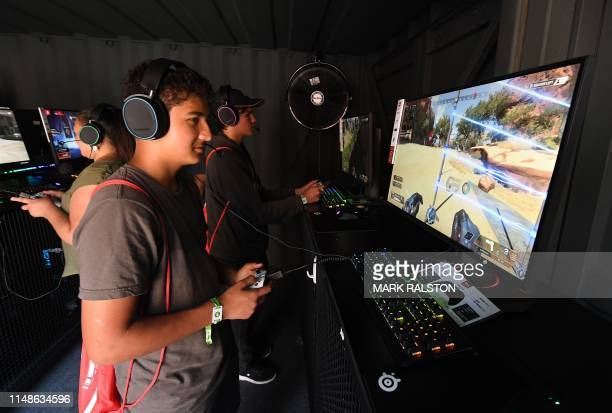 Gamers play a new version of the 'APEX Legends' video game at the EA PLAY event in Hollywood California on June 8 2019