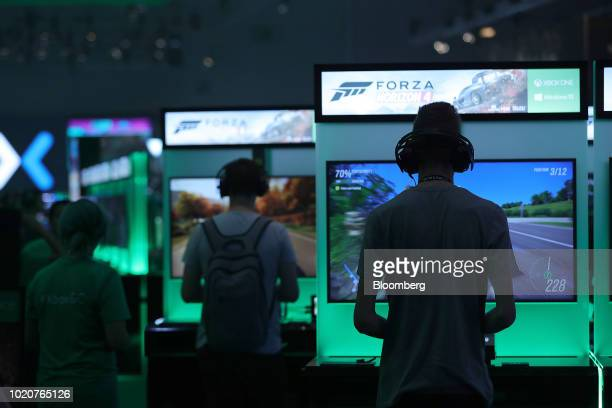 Gamers play 'Forza Horizon 4' computer games using XBox consoles at the Microsoft Corp. Stand at the Gamescom gaming industry event in Cologne,...