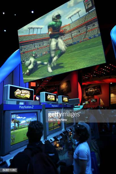 Gamers play on PlayStation 2's on opening day of the 10th annual Electronic Entertainment Expo on May 12, 2004 in Los Angeles, California. E3 bills...