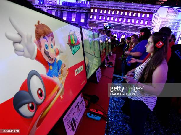 Gamers play the new Nintendo Switch console at the Los Angeles Convention center on day three of E3 2017 the three day Electronic Entertainment Expo...