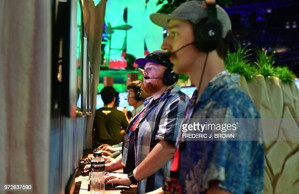 Gamers play the survival game Fortnite on PS4 at the 24th Electronic Expo or E3 2018 in Los Angeles California on June 12 where hardware...