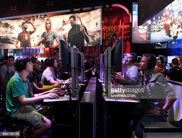 Gamers play the Ubisoft 'Rainbow Siege' game at the Los Angeles Convention center on day one of E3 2017 the three day Electronic Entertainment Expo...