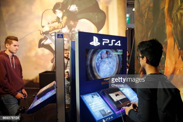 Gamers play the video game 'AOT2' on Sony PlayStation game consoles PS4 Pro during the 'Paris Games Week' on November 02 2017 in Paris France 'Paris...