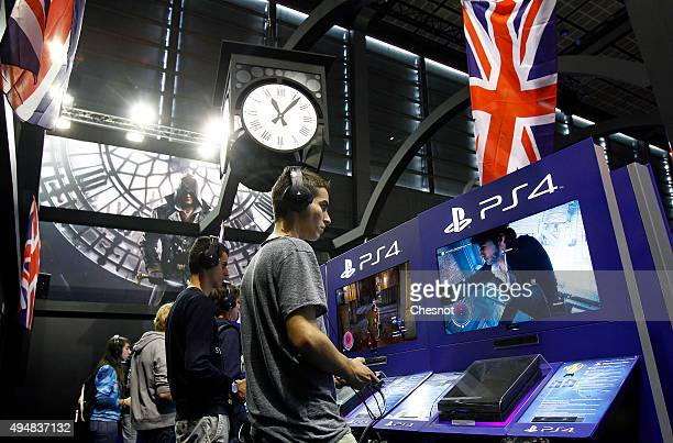 Gamers play the video game Assassin's Creed Syndicate developed by Ubisoft on PlayStation games consoles PS4 at Paris Games Week a trade fair for...