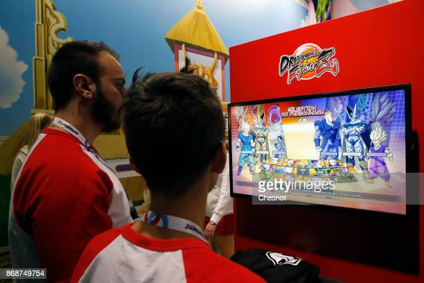 Gamers play the video game 'Dragon Ball Fighter Z' developed by Arc Systems Works and published by Bandai Namco Entertainment during the 'Paris Games...