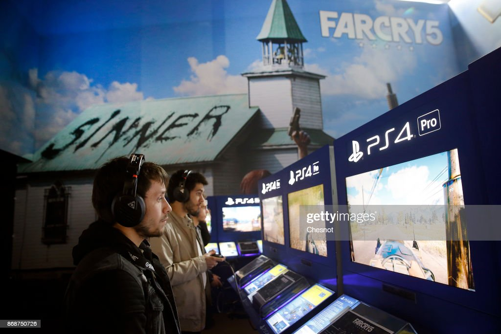 Gamers play the video game 'Far Cry 5' developed and published by Ubisoft on Sony PlayStation game consoles PS4 Pro during the 'Paris Games Week' on October 31, 2017 in Paris, France. 'Paris Games Week' is an international trade fair for video games to be held from October 31 to November 5, 2017.
