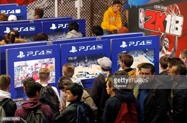Gamers play the video game 'NBA 2K18' developed by Visual Concepts and published by 2K Sports on Sony PlayStation game consoles PS4 Pro during the...