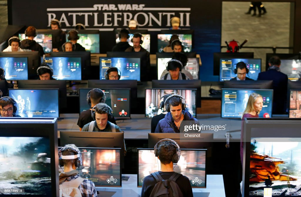 Gamers play the video game 'Star Wars Battlefront II' developed by DICE, Criterion Games and Motive Studios and published by Electronics Arts on Sony PlayStation game consoles PS4 Pro during the 'Paris Games Week' on October 31, 2017 in Paris, France. 'Paris Games Week' is an international trade fair for video games to be held from October 31 to November 5, 2017.