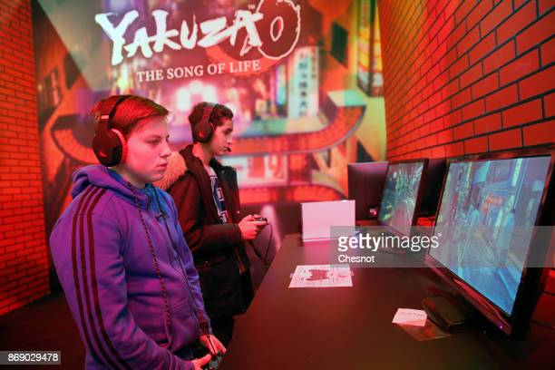 Gamers play the video game 'Yakuza' developed by Amusement Vision and published by Sega during the 'Paris Games Week' on November 01 2017 in Paris...