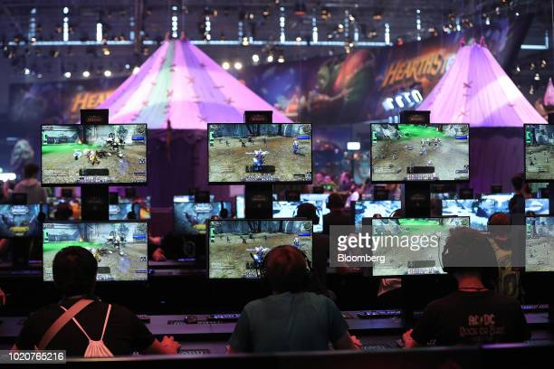 Gamers play the 'World of Warcraft' computer game at the Gamescom gaming industry event in Cologne, Germany, on Tuesday, Aug. 21, 2018. Gamescom is...