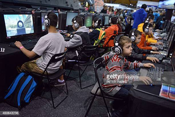 Gamers play video games as they attend the Supanova Pop Culture Expo in Sydney on June 15 2014 The threeday event in which thousands of fans dress up...