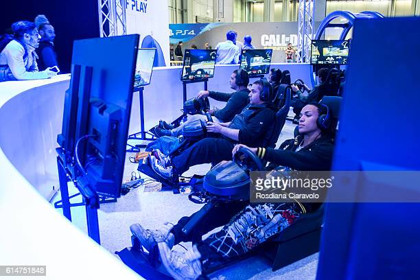 Gamers playing GT Sport at the Playstation 4 stand during the Milan Games Week 2016 on October 14 2016 in Milan Italy
