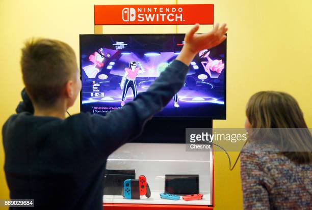 A gamers plays the video game 'Just Dance 2018' developed and published by Ubisoft on a Nintendo Switch games console during the 'Paris Games Week'...