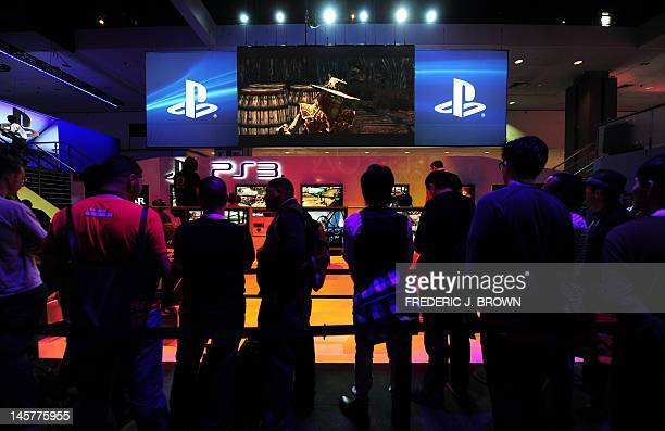 Gamers sample games at the Nintendo section on the opening day of the E3 videogame conference in Los Angeles on June 5 2012 in California where...