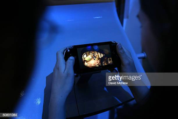 Gamers try Sony's initial entrant into the handheld gaming device market the PlayStation Personal on opening day of the 10th annual Electronic...