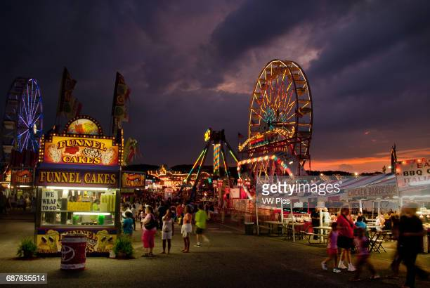 Games and rides illuminated against the night sky at the Maryland State Fair