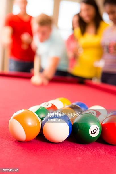 Games: Billiards balls. Pool table. Friends ready to break. Cue.