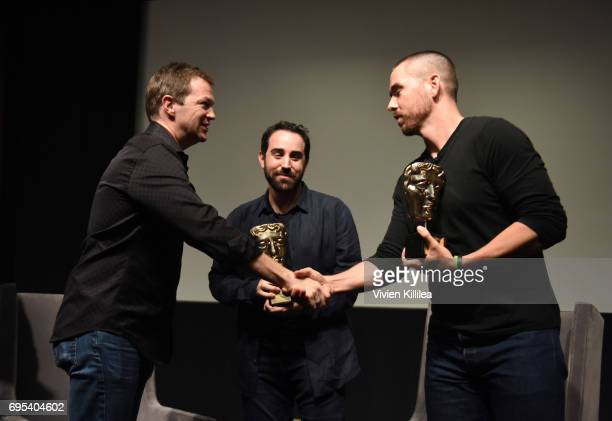 Games Committee Chair Nick ButtonBrown presents cofounders and coCEOs of Riot Games Brandon Beck and Marc Merrill with their awards at BAFTA Honours...