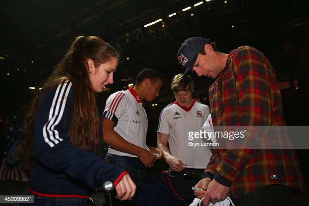 Games gold medalist Travis Pastrana signs autographs for Abby Taylor of British Cyclng prior to the Nitro Circus Live Show at the MEN Arena on...