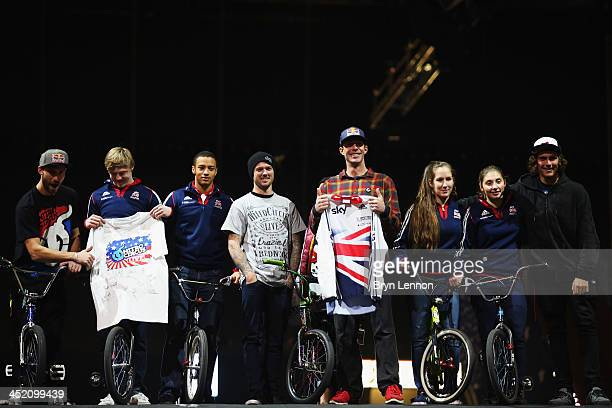Games gold medalist Travis Pastrana swaps shirts with British Cycling's Kyle Evans during a photo call prior to the Nitro Circus Live Show at the MEN...