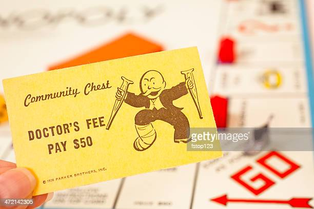 games: monopoly board game. 'doctor's fee' community chest card. - fee stock pictures, royalty-free photos & images