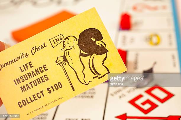 Games: Monopoly board game. 'Life Insurance' community chest card.