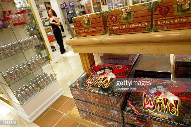Games with a sexual theme sit on a shelf at the Penthouse Boutique August 10 2003 in Milford Connecticut The Penthouse Boutique which is not owned by...
