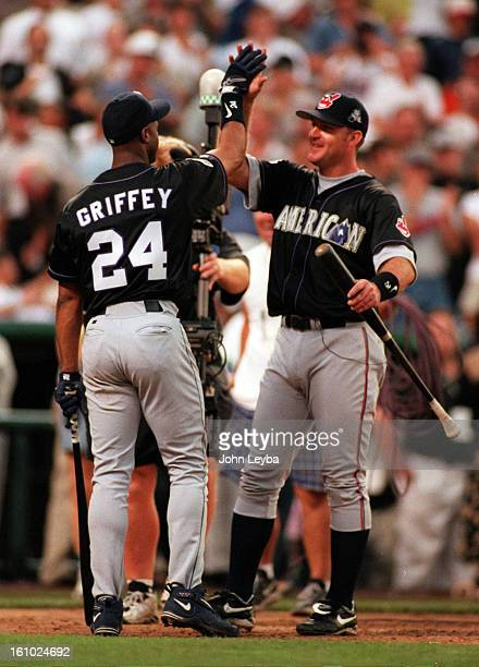 Seattle Mariners slugger Ken Griffey Jr. High fives Jim Thome after winning the homerun derby in the 69th All-Star game at Coors Field. Griffey beat...