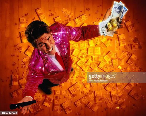 gameshow host surrounded by cash, overhead view (digital composite) - television host stock pictures, royalty-free photos & images