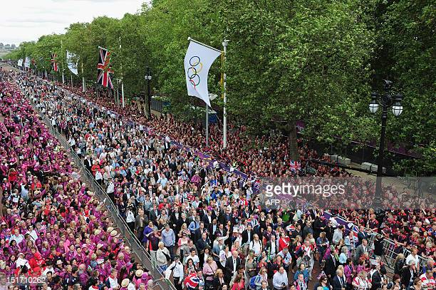 Gamesmakers and spectators head along the Mall toward Buckingham Palace at the end of a parade celebrating Britain's athletes who competed in the...