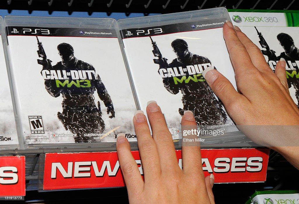 Gamestop Employee Randi Taber Stacks Copies Of Call Of Duty