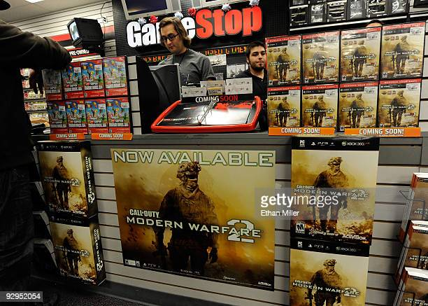 GameStop workers Patrick Moulin and Brandon Khan get ready to sell copies of the highly anticipated video game Call of Duty Modern Warfare 2 at a...