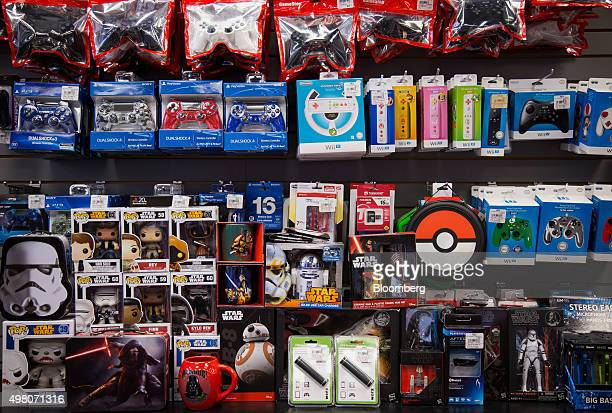 Gaming accessories and Star Wars merchandise are displayed for sale at a GameStop Corp store in New York US on Wednesday Nov 18 2015 GameStop Corp is...