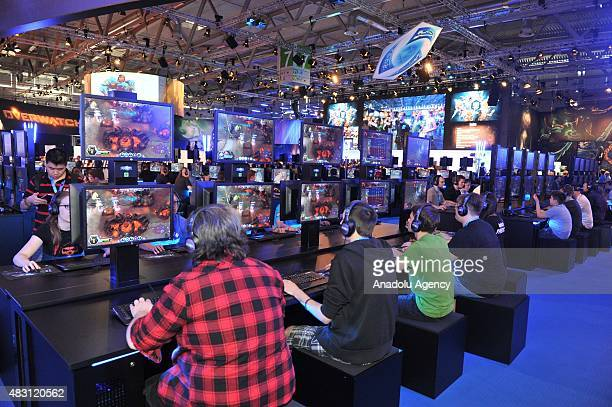Gaming enthusiasts attend world's one of the largest trade fair 'Gamescom' gaming fair in Cologne Germany on August 5 2014